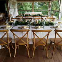 Crossback Chairs At White Linen Table