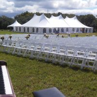Tent With White Resin Chairs